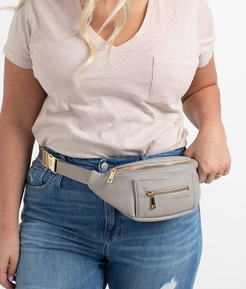 Front view zoomed model wearing Fawn Design Gray Fawny Pack. Fanny Pack, Belt Bag.