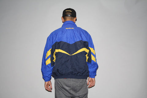 1990s Vintage 90s Colorblock Reebok Oversized XL Graphic Blue and Yellow Hip Hop Rap Rapper Windbreaker Jacket