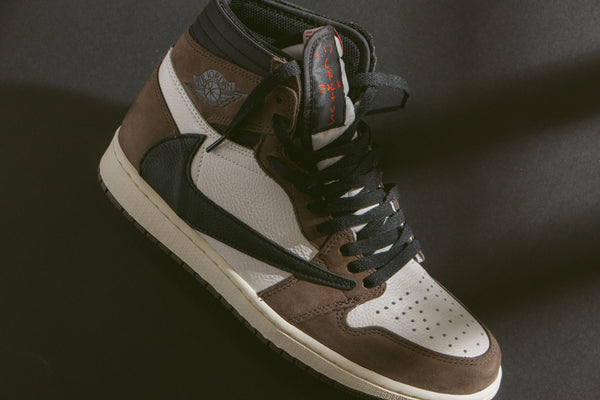 "410bca617ab ... duo unveils the highly anticipated Jordan x Travis Scott 1 Retro High  OG SP ""Cactus Jack."" The updated classic stitches a backwards Nike Swoosh at  ..."