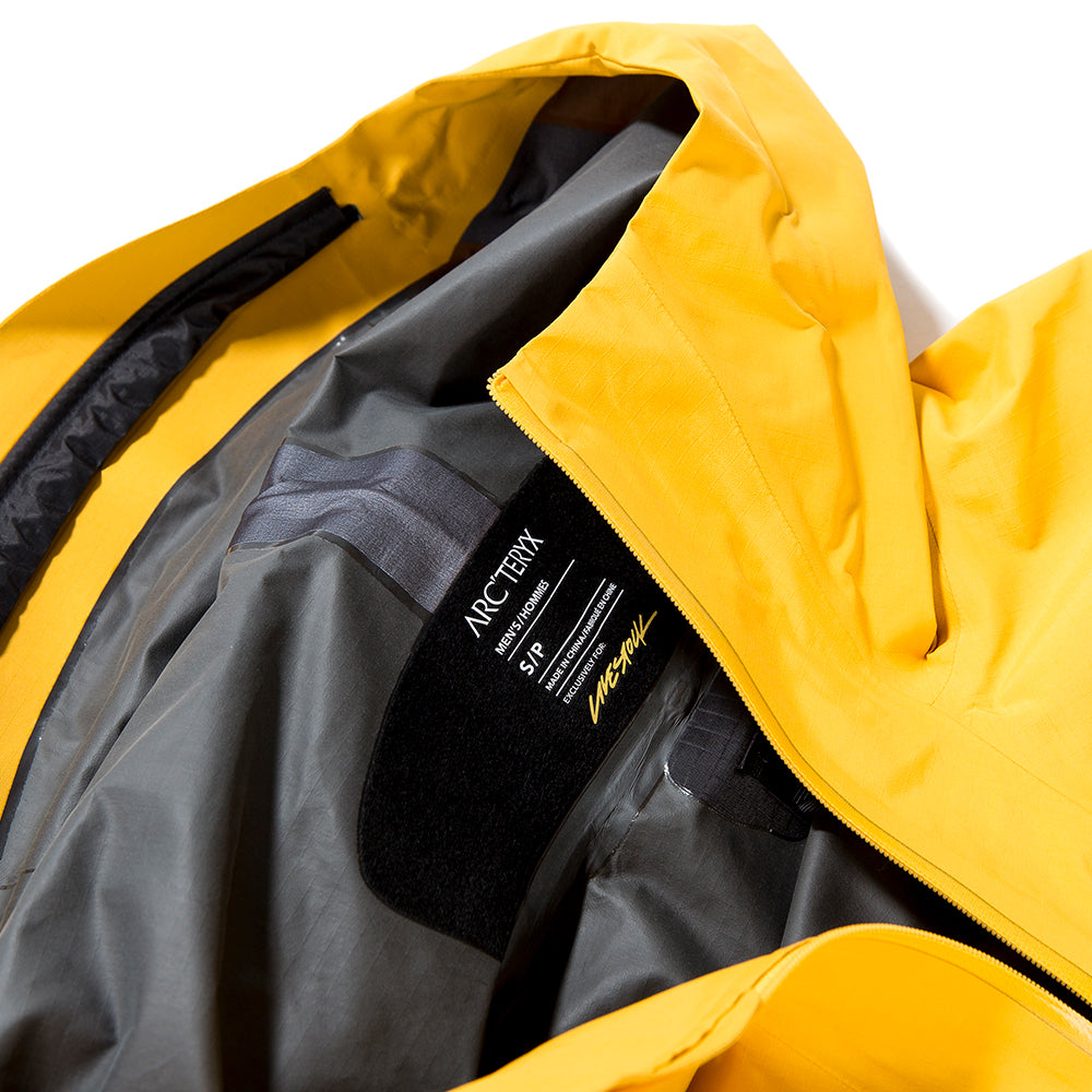 Style code 24891. Arc'teryx Alpha SL Pullover Jacket Exclusively For Livestock / Concrete Amber