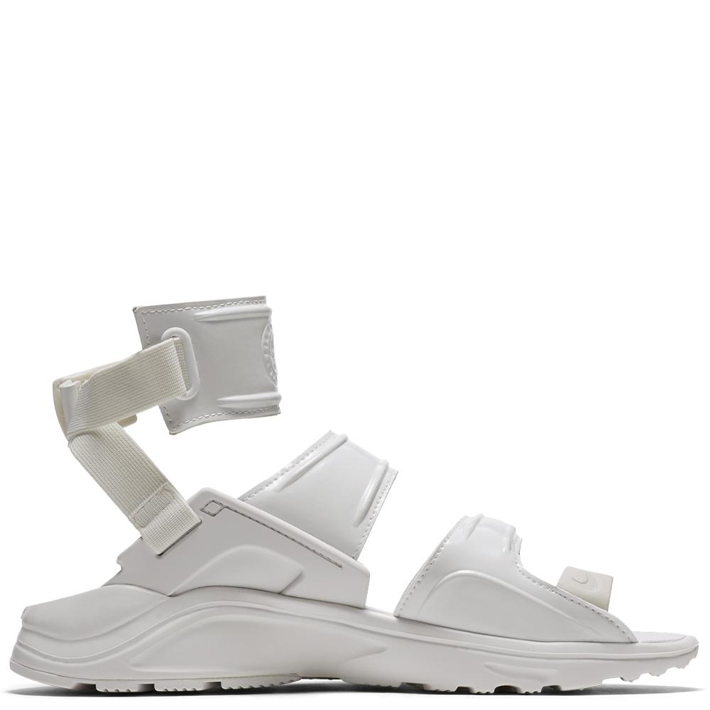 style code AH7702100. NIKE WOMEN'S AIR HUARACHE GLADIATOR QS / SUMMIT WHITE