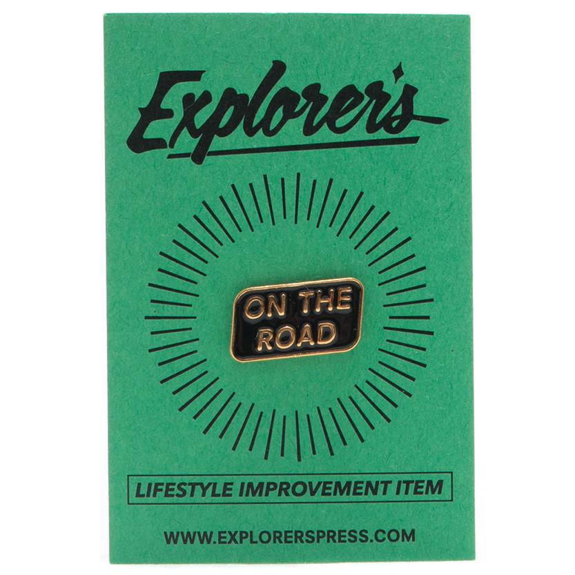 EXPLORER'S PRESS ON THE ROAD LAPEL PIN. style code EXP20