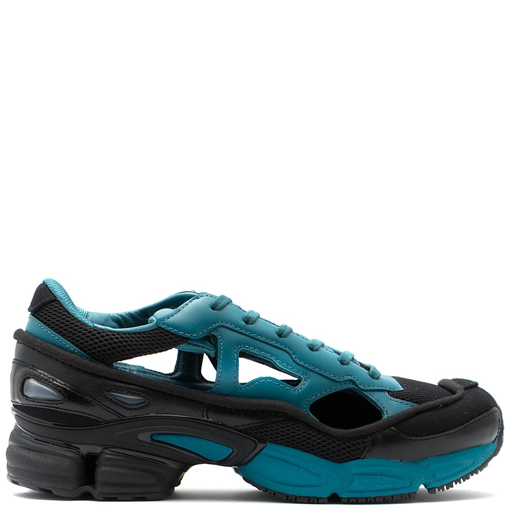 Style Code BB7986. ADIDAS BY RAF SIMONS REPLICANT OZWEEGO CORE BLACK / COLONIAL BLUE