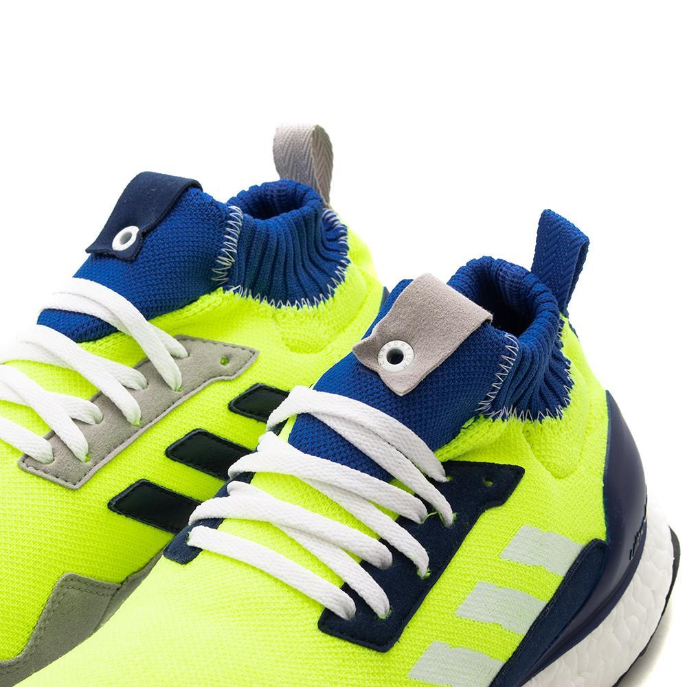 7561e90809343 ... coupon code for style code bd7399. adidas consortium workshop ultraboost  mid proto solar yellow 40d7b