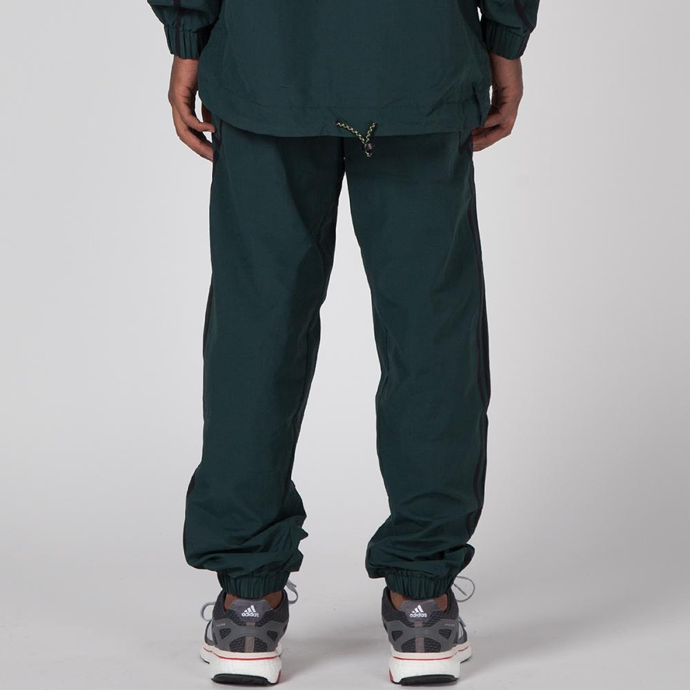 style code BR5085. ADIDAS TAPED WIND PANT / GREEN NIGHT