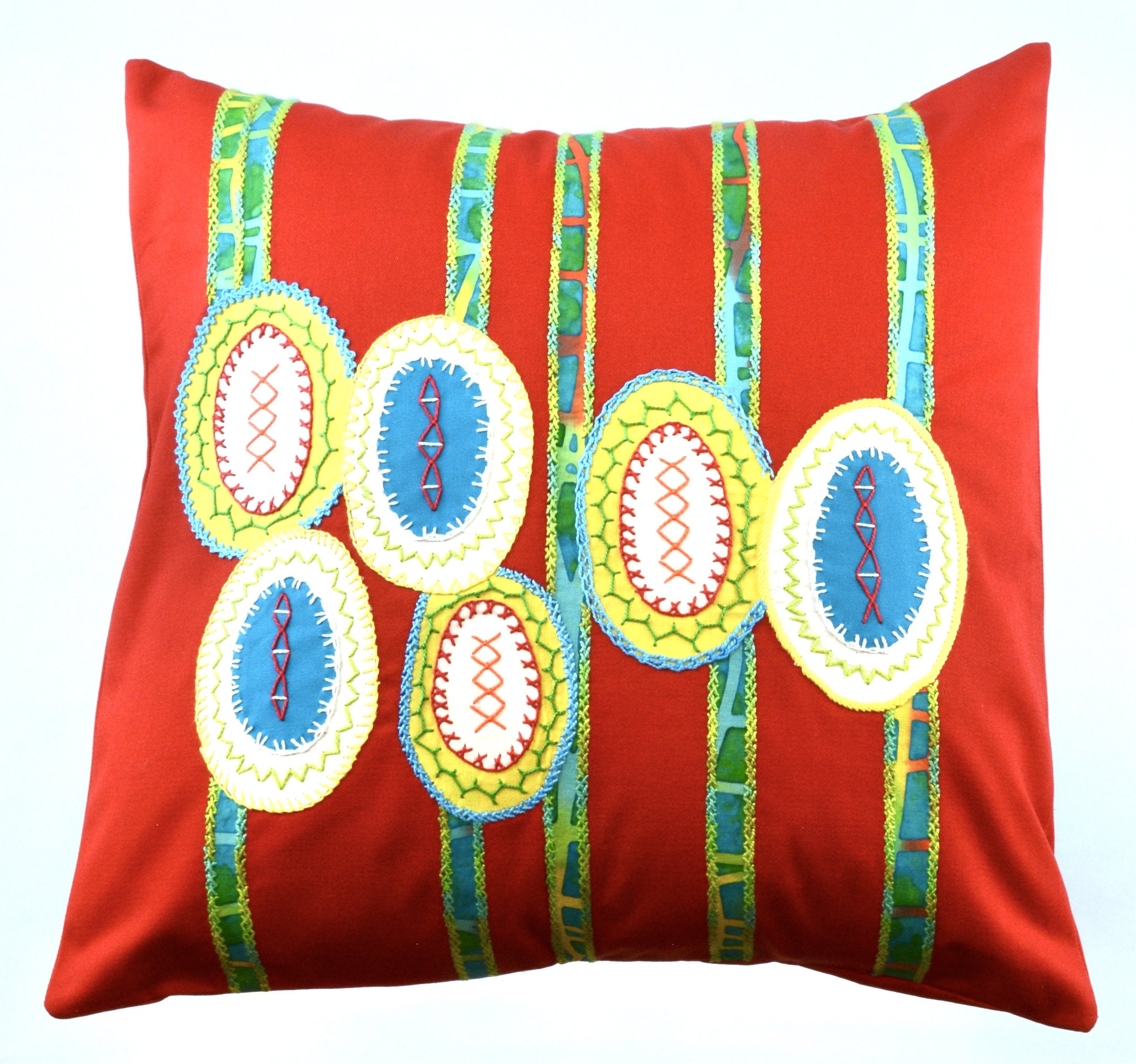 MARACAS DESIGN EMBROIDERED PILLOW ON RED