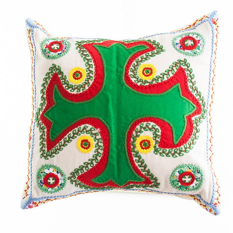 Cruz Dominicana Design Embroidered Pillow on stone