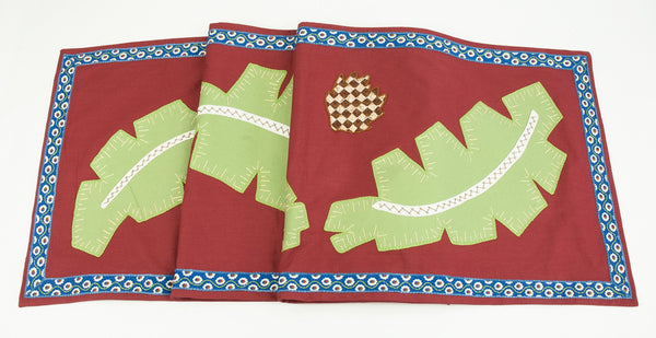 Hojas Design Embroidered Table Runner on red