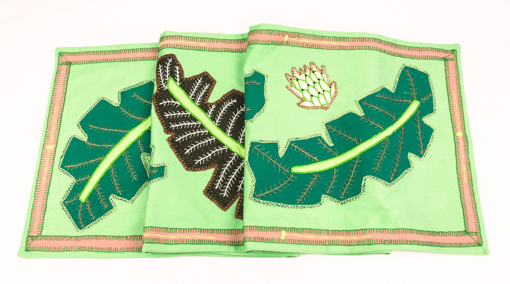 Hojas Design Embroidered Table Runner on light green