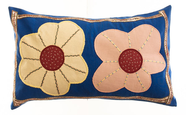 Dos Flores Design Embroidered Pillow on royal blue