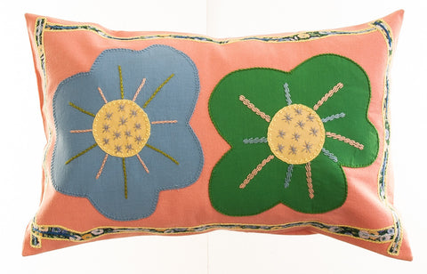 Dos Flores Design Embroidered Pillow on salmon