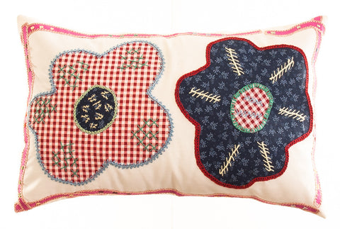 Dos Flores Design Embroidered Pillow on red