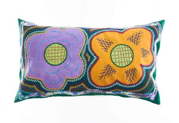 Dos Flores Design Embroidered Pillow on green