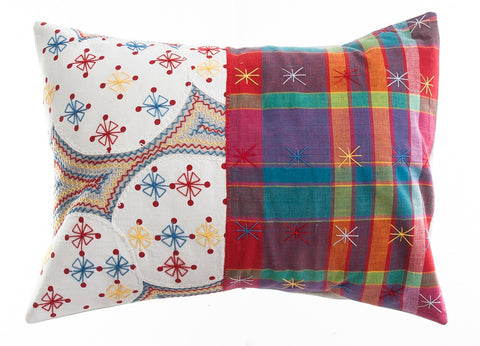 Cuadritos Design Embroidered Pillow on stone