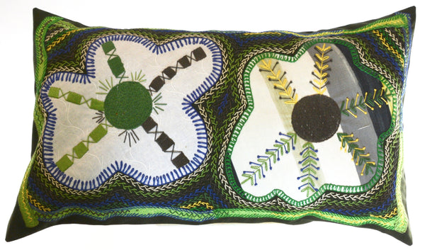 Dos Flores Design Embroidered Pillow on dark green
