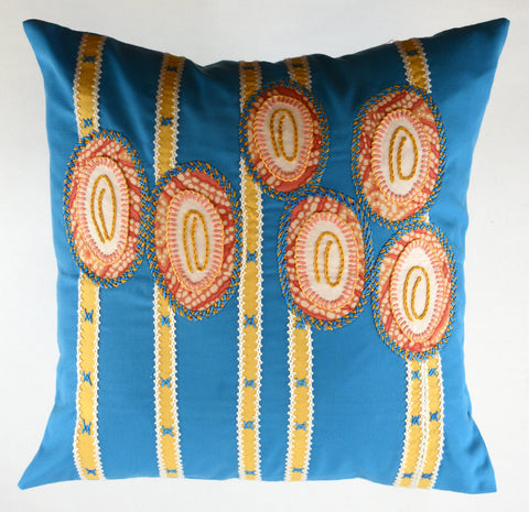 Maracas Design Embroidered Pillow on turquoise