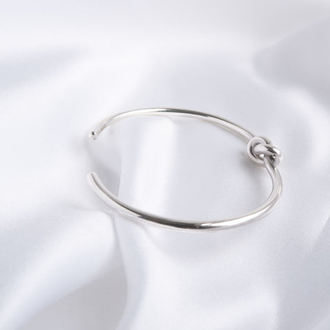 Carolyn Sterling Silver Love Knot Torque Bangle
