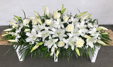 Coffin Casket Spray in White lily funeral flowers delivery by florists in Wellington NZ order online