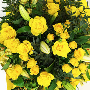 Yellow roses and White lilies bouquet
