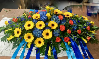 Coffin casket flowers in Bright Mix colours - funeral flowers by florists in Wellington NZ