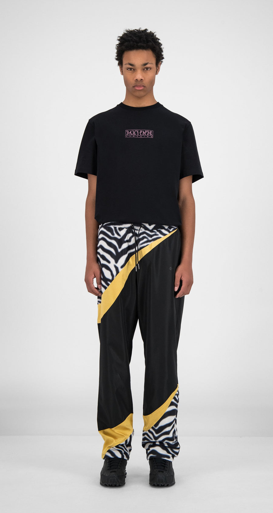 Daily Paper - Black Zebra Gold Huko Pants - Men Front