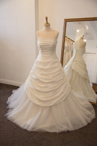 Justin Alexander ivory bridal dress with full train
