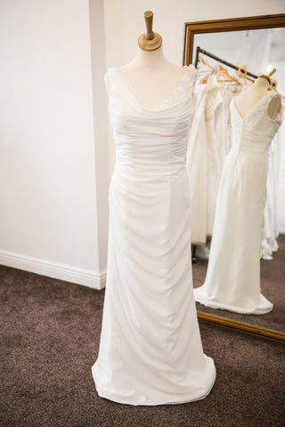 Sacha James ivory bridal dress with delicate flower detail to left shoulder