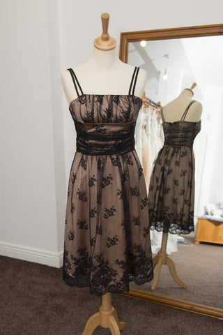 Awear dark gold dress with black lace overlay.