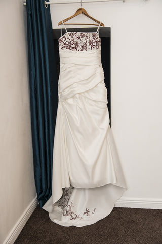 White bridal dress with wine embroidered detail