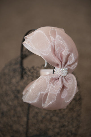 Dusky pink bow on black hairband with crystal detail