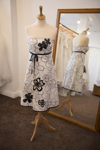 Debut white knee length dress with black embroidered flower design