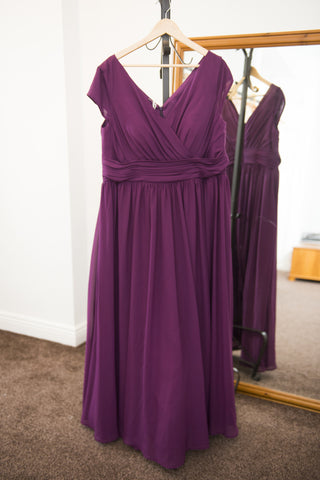 Deep purple full length dress with v-neckline