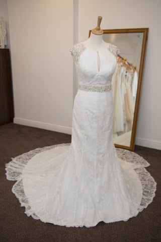 Maggie Sottero ivory bridal dress with beaded embellishments