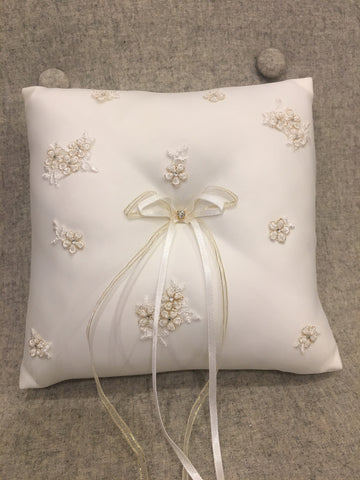Ivory ring cushion with gold and ivory detail