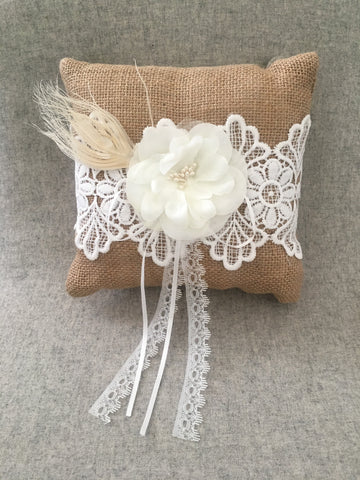 Hessian ring cushion with flower, feather and lace detail