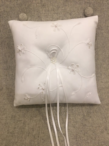 White ring cushion with embroidered detail