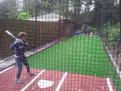 batting cage, stance mat, pitching machine