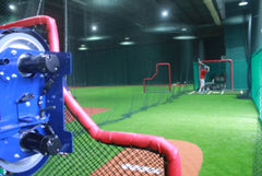 Batting cages, pitching machines, L screens, in the Singapore facility