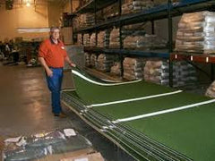 Owner Arnald Swift at factory with stacks of stance mats, we get them from the source