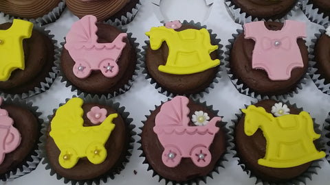 baby shower pink and yellow cupcakes