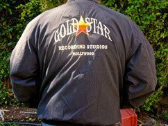 Black Windbreaker with Gold Star Logo