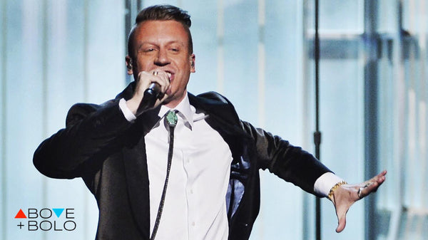 Macklemore wears a Bolo Tie while performing at the Grammys