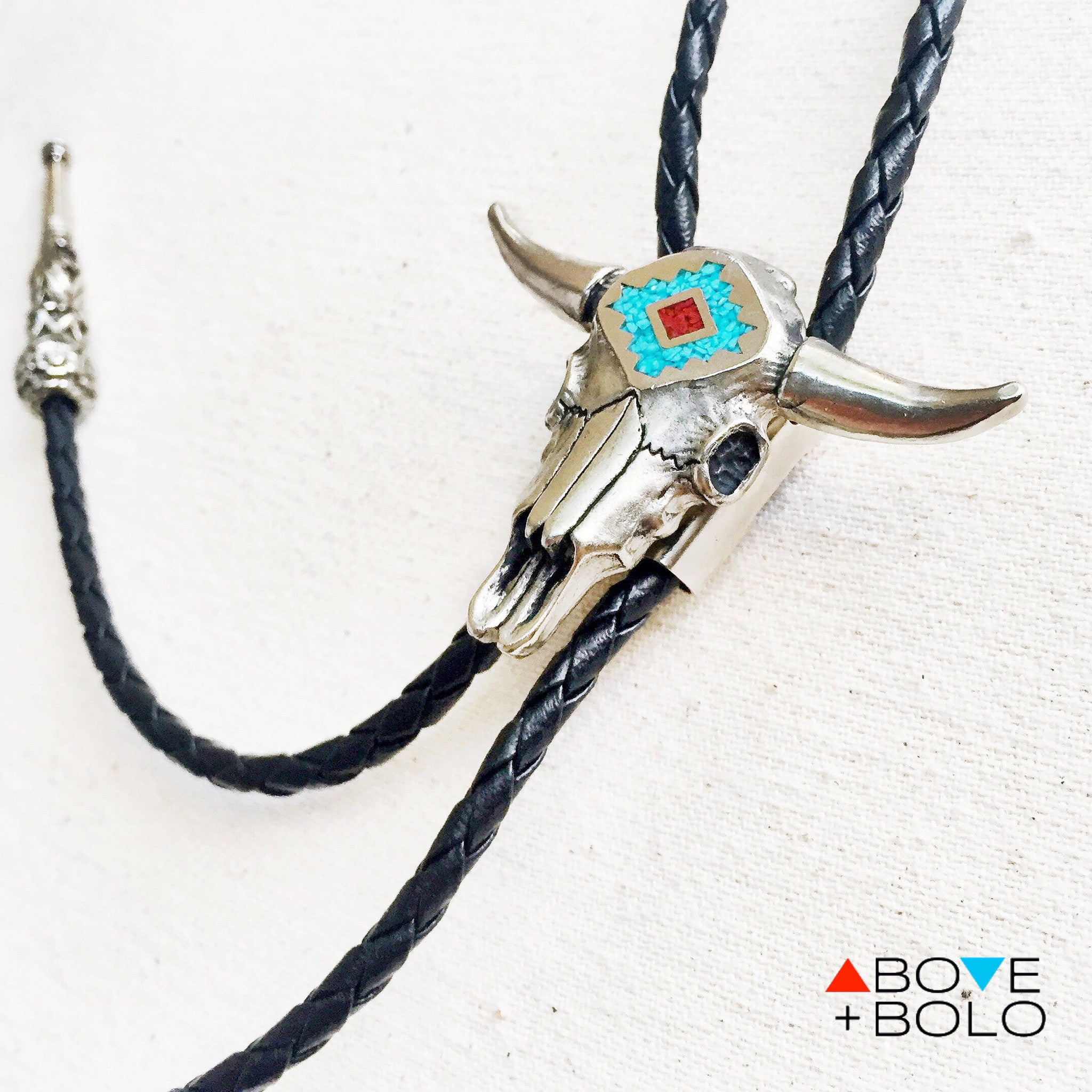 6b4e98eb56bb ... bullskull bolo tie with genuine turquoise and coral chip inlays with  ornate tips · steer skull ...