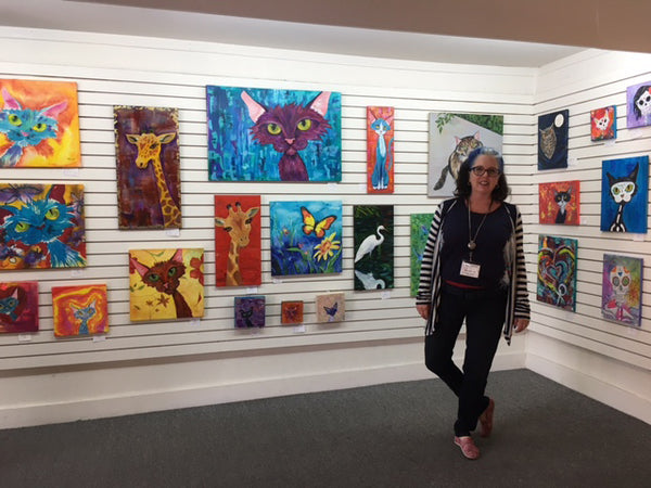 Padgett Mason with her pet portrait art and funky feline paintings