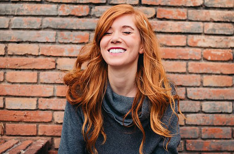 This Ancient Grain Could Seriously Strengthen Your Hair Article Image Of Girl With Long Red Hair Smiling At The Camera