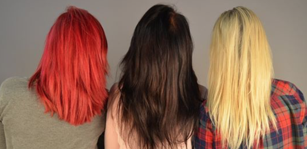 Researchers Reveal Hair Dyes Have a Direct Connection to Breast Cancer article image. Three women with differently colored dyed hair