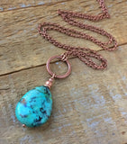 Blue green turquoise teardrop stone pendant on an antiqued copper chain