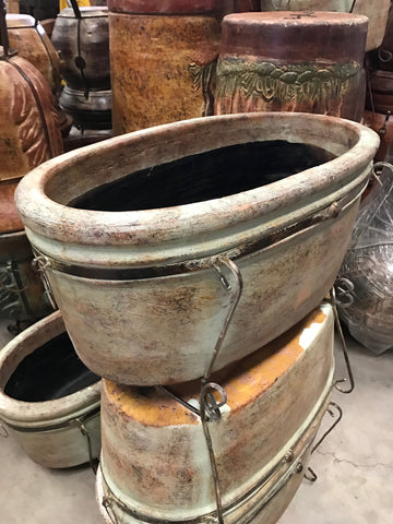 Large clay boat style pot with iron