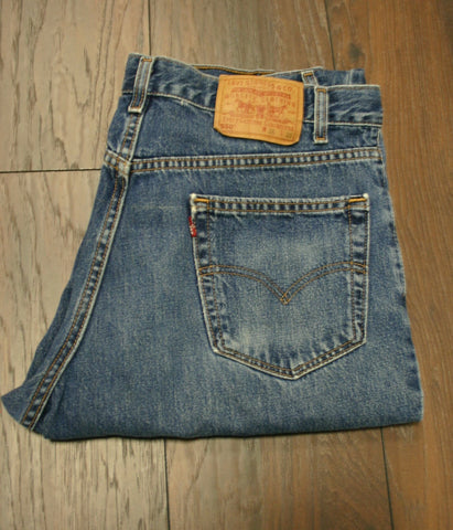 Great Pair of Men's Levis 550 Size 36/30 Made In USA, Minor Wear, One Worn Spot Near Knee Of One Leg About The Size Of A Dime. Nice Fading. Medium Wash Relaxed Fit.