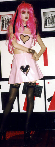 Short vinyl A line skirt with see through heart cut out